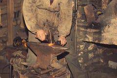 Detail shot of hammer forging hot iron at anvil Royalty Free Stock Photos