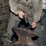 Detail shot of hammer forging hot iron at anvil Royalty Free Stock Image