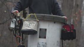 Detail shot of a man raising a utility bucket