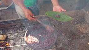 Detail Shot Of Man Serving On A Leaf Cooked Organic Cocoa Paste. In Ecuador stock video footage