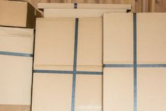 Stacked cardboard boxes in a warehouse stock photos
