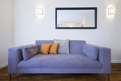Detail shot of modern living room. With large sofa Royalty Free Stock Photo
