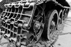 Detail shot with old vintage tank tracks and wheels. Stock Image