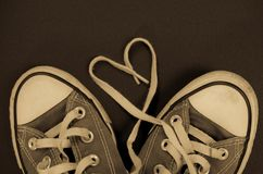 Retro sneakers heart shaped laces. Detail shot of a pair of sneakers converse all-stars Royalty Free Stock Photos