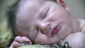 Detail shot of a peaceful baby's face stock video footage