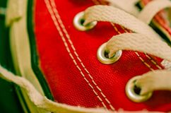 Running shoe. Detail shot of red sneakers converse all-stars Royalty Free Stock Images