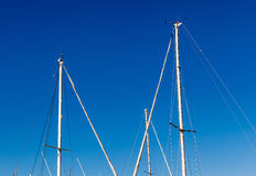 Detail shot of sailing boat poles in marina. Royalty Free Stock Photo