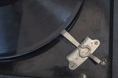 Detail shot of a speed controller of a portable gramophone from Germany in the 1920s. Detail shot of a speed controller of a historic phonograph gramophone from stock photography