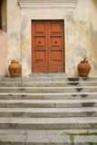 Detail shot of steps leading to two doors in Portoferraio, Province of Livorno, on the island of Elba in the Tuscan Archipelago of Stock Image