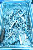 Detail shot of steralized surgery instruments with a hand grabbing a tool Royalty Free Stock Image