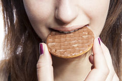 Detail shot of young woman eating cookie Royalty Free Stock Photos