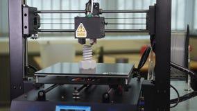 3D printer printing a gray screw. Detail shots of a 3d printer printing a big gray screw stock video