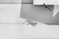 Detail of shutters on the window with the shadow on the wall Stock Photography