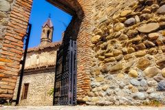 Detail of Sighnaghi church tower framed in ancient stone wall, Georgia Royalty Free Stock Photo