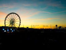 Detail And Silhouette of Ferris Wheel with Sun Set Royalty Free Stock Photography