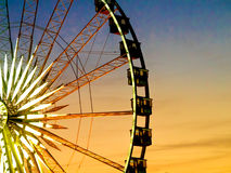 Detail And Silhouette of Ferris Wheel with Sun Set Stock Photos