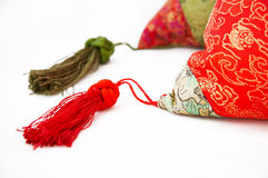 Detail of silk pillow. Silk pillow with very nice detail.ichinese style,solated on white stock photography