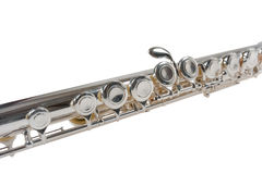 Detail of a Silver Flute on White Royalty Free Stock Images