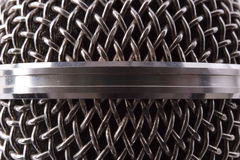 Detail of silver metal microphone grille. Front view. Horizontal composition stock images