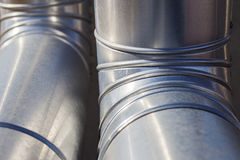 Industrial heating ducts. Detail of silvered heating ducts Stock Photos