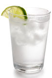 Detail of a simple glass of water. With floating ice cubes and lime slice Stock Photo