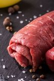 Detail of single beef slice rolled and prepared for roulade Stock Photography