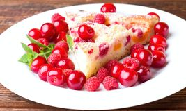 Detail of single portion of fruit pie with berries around stock photo