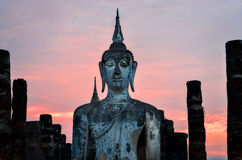 Detail of sitting Buddha at sunset in Sukhothai, Thailand Stock Images