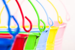 Detail of six coloured buckets. Six detailed coloured buckets in one diagonal line royalty free stock photography