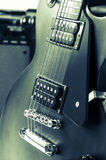 Detail of six-string electric guitar closeup, selective focus.Processed with vintage style Royalty Free Stock Photo