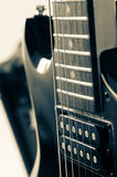 Detail of six-string electric guitar closeup, selective focus.Processed with vintage style Royalty Free Stock Images