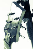 Detail of six-string electric guitar closeup, selective focus.Processed with vintage style Royalty Free Stock Photos
