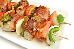 Detail of skewer meat and vegetables Stock Photos
