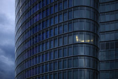 Detail of skyscraper. Skyscraper with one illuminated office royalty free stock photo