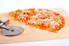 Detail of slices Italian pizza and cutter Royalty Free Stock Image
