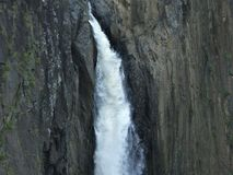 Detail of a small waterfall, the water crashes down the rocks stock images