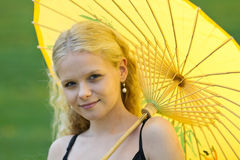 Detail of smiling girl with yellow. Detail of smiling young girl with yellow parasol stock photos