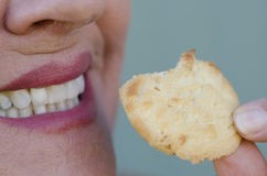 Detail smiling woman biting sweet cookie snack Stock Image