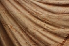 Smudge on old brown cloth for background Royalty Free Stock Image