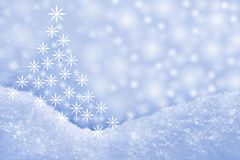 Detail of snowdrift and Christmas tree Stock Photos