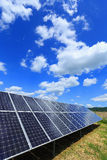 Detail of Solar Power Station with blue cloudy Sky Royalty Free Stock Images