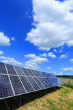Detail of Solar Power Station with blue cloudy Sky Stock Images