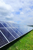 Detail of the Solar Power Station on the spring flowering Meadow Royalty Free Stock Photos