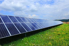 Detail of the Solar Power Station on the spring flowering Meadow Stock Images