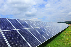 Detail of the Solar Power Station on the spring flowering Meadow Stock Photo