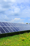Detail of the Solar Power Station on the spring flowering Meadow Royalty Free Stock Photography