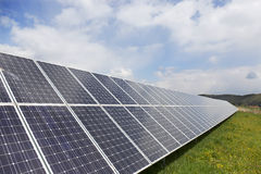 Detail of the Solar Power Station on the spring flowering Meadow in the sunny Day Royalty Free Stock Image