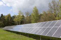 Detail of the Solar Power Station on the spring flowering Meadow in the sunny Day Stock Photography