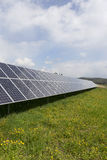 Detail of the Solar Power Station on the spring flowering Meadow in the sunny Day Stock Image