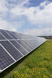 Detail of the Solar Power Station on the spring flowering Meadow in the sunny Day Royalty Free Stock Images